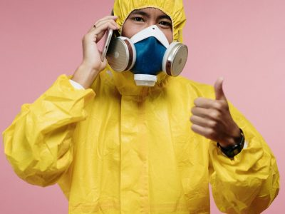 LASTperson-in-yellow-protective-suit-talking-on-the-phone-3951396 (1)